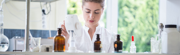 Young female pharmacist working in chemistry laboratory